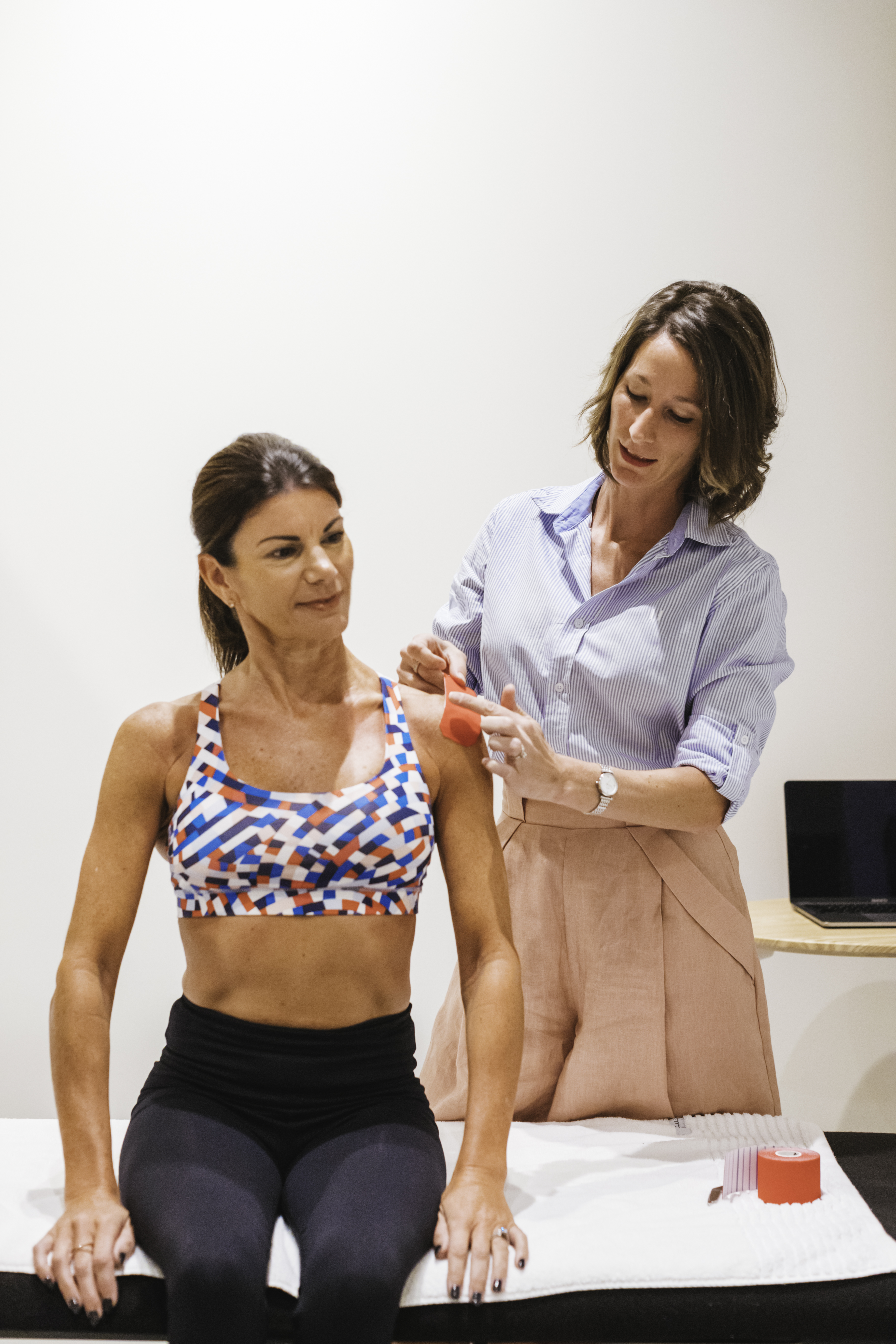 a physiotherapist working during a session